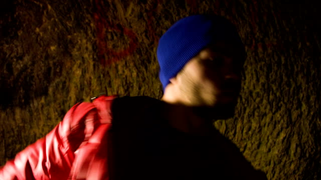 Young man dancing in the cave. video