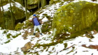 Young man dancing on a rock video