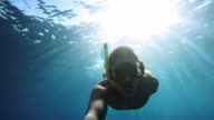 POV Young man diving with snorkeling mask video