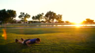 Young Man Doing Burpees in the Park video