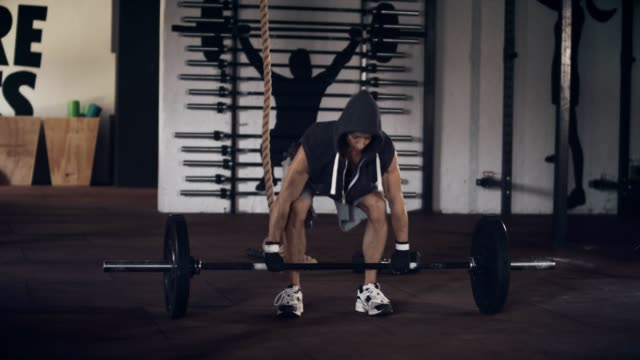 Young man doing deadlifts in gym video
