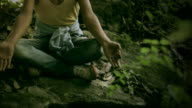 Young man doing meditation yoga in woods. video
