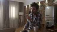 Young man drinking coffee in the morning video
