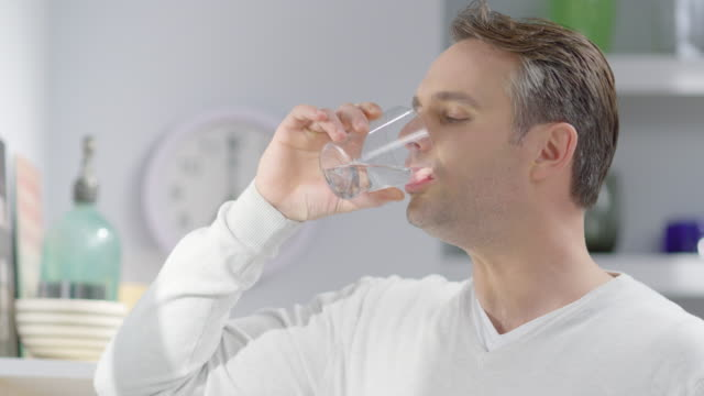 Young man drinking water video