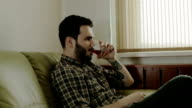 A young man drinking whiskey. video