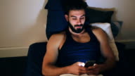 Young man enjoying at home video