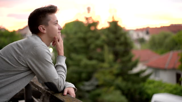 Young man enjoying at sunset. video