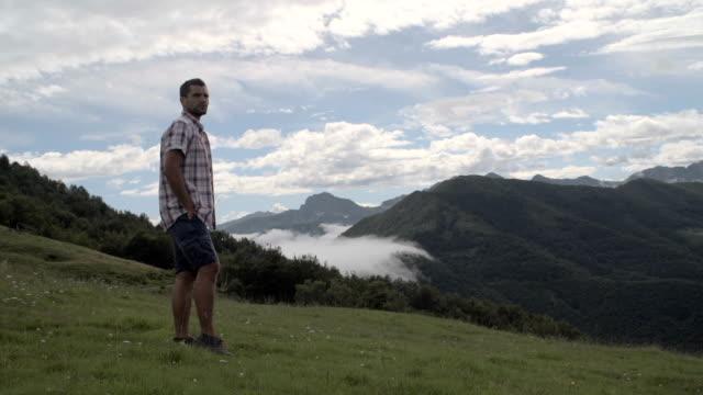 Young man enjoying the panorama on mountain video