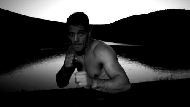 Young man exercising shadow boxing video