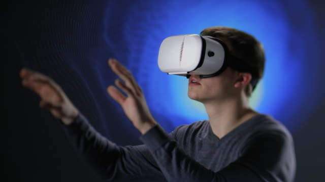 Young man exploring new virtual world video