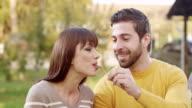 Young man feeding woman video