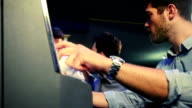 Young man gambling on slot machines video