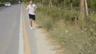 Young Man Getting His Breath While Jogging video