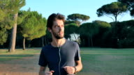 young man goes jogging in the middle of nature video