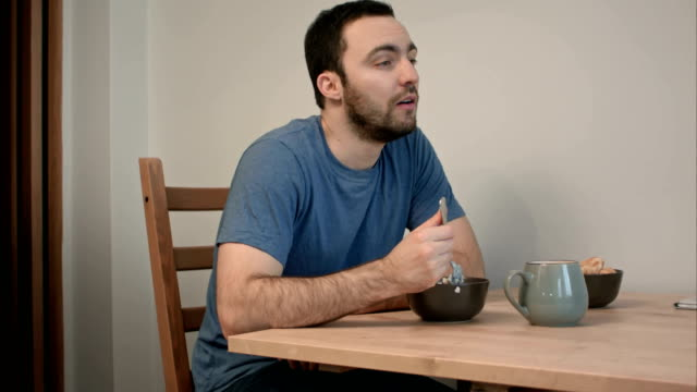 Young man having no appetite for his breakfast video