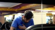 Young man having palpitation on the treadmill video