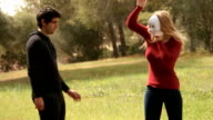 young man helping woman with mask as symbol of unreal emotions for psychology concepts video