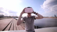 Young man in 360 VR glasses. Virtual reality glasses video
