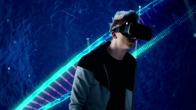 Young man in digital world. Exploring virtual reality video