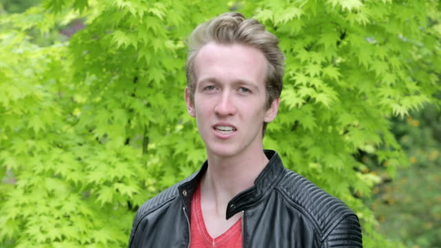 young man in leather jacket looking upset video
