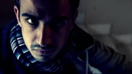 young man in the darkness with sinister look video