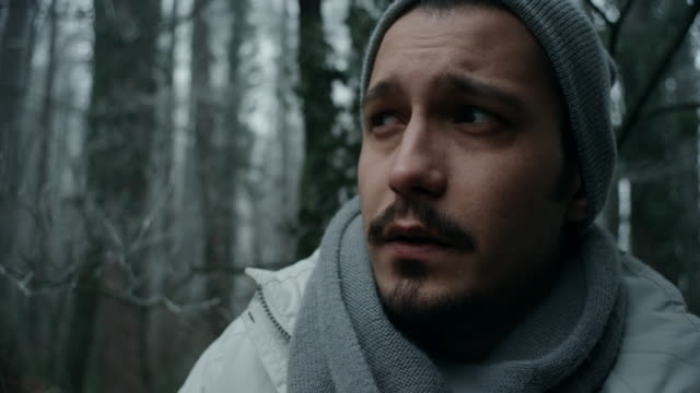 Young man in the frozen forest video