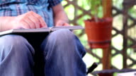 Young man in wheelchair reading video