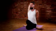 Young man in yoga meditation posture video