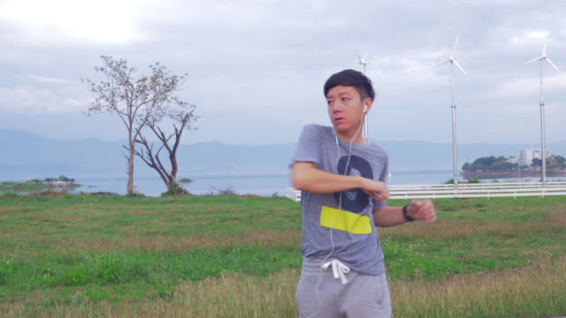 Young man is doing an exercises in the morning video