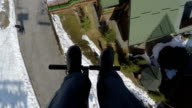 Young man is riding a ski lift. video
