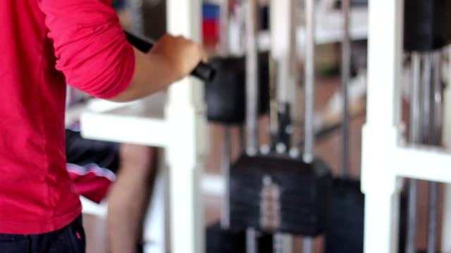young man is working triceps. video