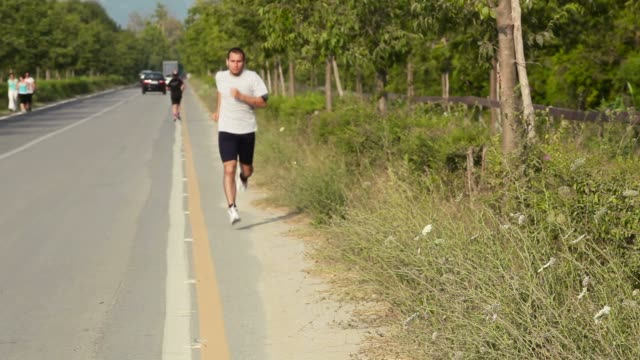 Young Man Jogging video