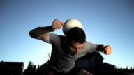 HD SUPER SLOW-MO: Young Man Juggling A Ball video