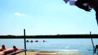 Young man jumping in lake video