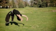young man jumping somersaults video