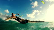 Young Man Kite Boarding in Ocean at Sunset. video