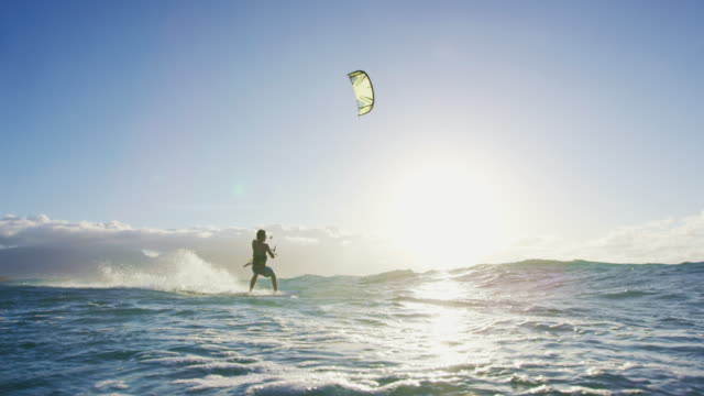 Young Man Kite Surfing in Slow Motion video