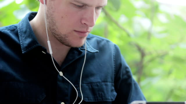 Young man learning, using ipad video