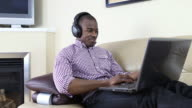Young man listening to music video