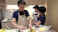 Young man Make a sweet food with Family video