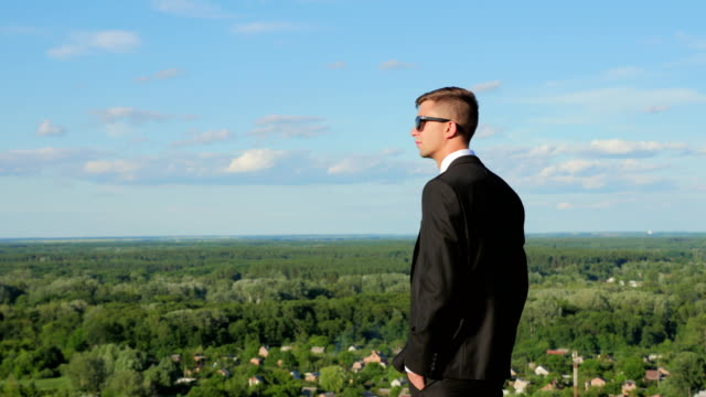 A Young Man On a Hill Looks Into the Distance video