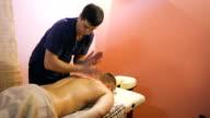 Young man on wellness treatments sports massage video