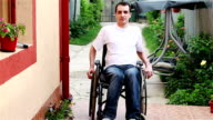 young man on wheelchair in the yard video