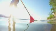 Young man paddleboarding video