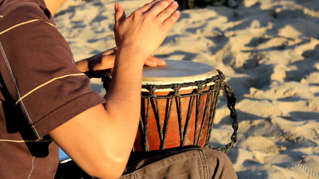 Young Man Playing Djembe Drum On The Beach video