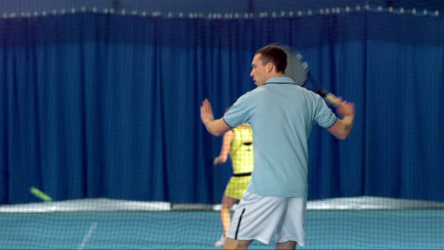 MS Young Man Playing Indoor Tennis video
