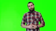 Young man posing on chromakey background video