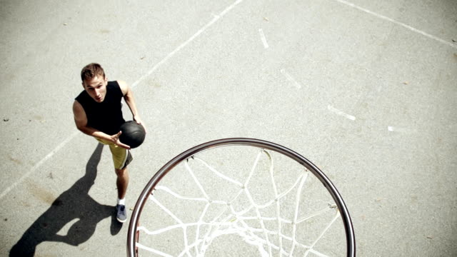 HD SUPER SLOW-MO: Young Man Practicing Basketball video