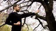 Young man practicing wing chun near the river video