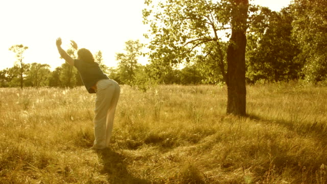Young man practicing yoga in a summer forest. video
